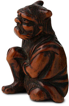 Netsuke oni applying moxa side